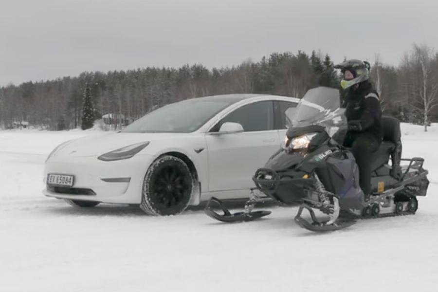 Tesla Model 3 vs. Electric Snowmobile Drag Race On Frozen Lake